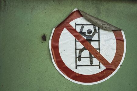 No climbing sign on an industrial wall Stock Photo