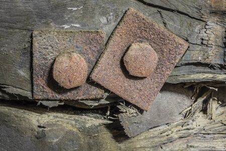 Rusty screws in a wooden construction