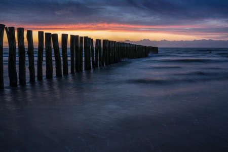 Sunset with a row of poles near Calais.