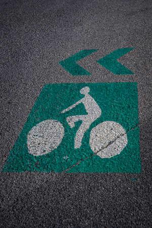bike lane sign on the asphalt