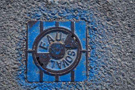 water valve cover in a french street