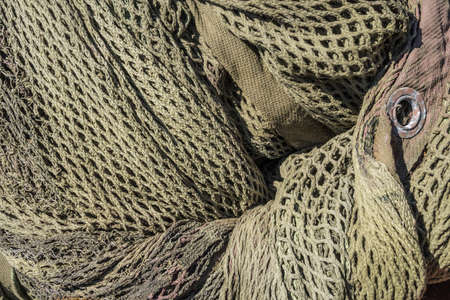 Detail of a historic military camouflage disguise net.