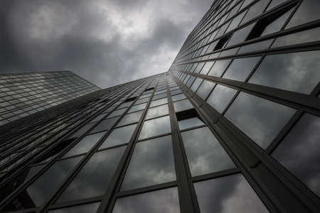 modern office building with storm clouds