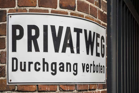 german do not enter sign on an old brick wall
