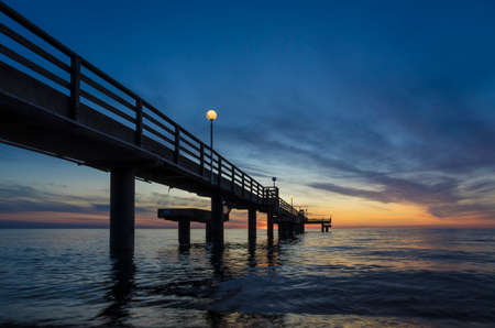 Pier on the baltic sea at sunset.