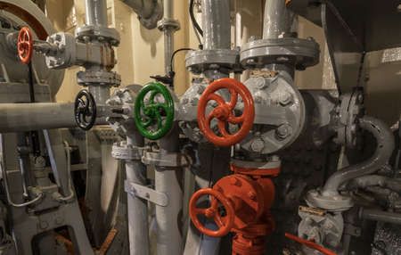 pipeline detail in an old ships machine room Archivio Fotografico