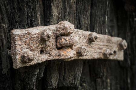 old wooden door with rusty hinge Archivio Fotografico