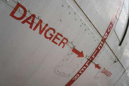 hazard sign on an old airplane hull Archivio Fotografico