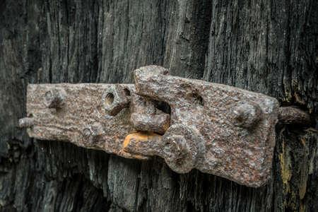 old wooden door with rusty hinge Standard-Bild