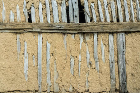 wooden framework wall with clay