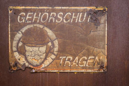 old german sign to wear ear protection Standard-Bild