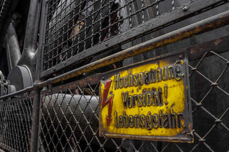 German high tension warning sign on a historic generator
