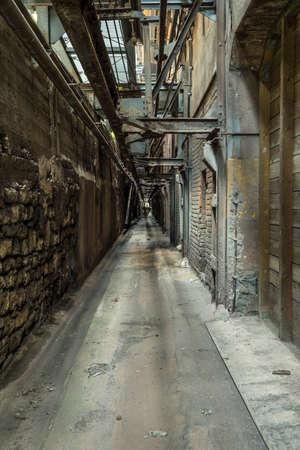 narrow aisle in a historic factory Standard-Bild