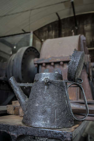 vintage oil container in a workshop