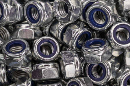 pattern of zinc plated screw nuts Banco de Imagens