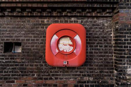 life buoy on an old brick wall