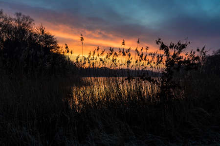 sunrise on a natural lake Standard-Bild
