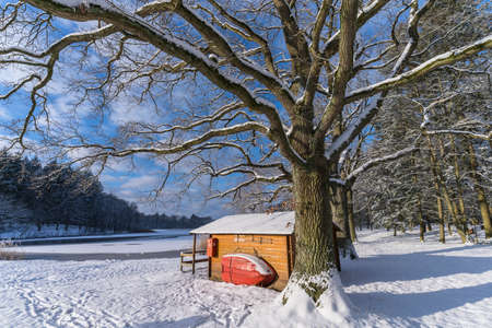 snow covered cabin in winter