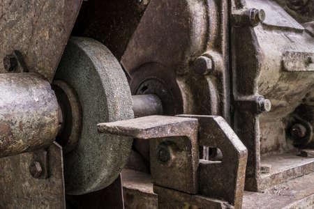 historic grinding machine in a workshop Standard-Bild