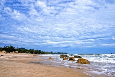 Blue sky with cloud scape, golden sand at sea. Travel to Vietnam Stock Photo