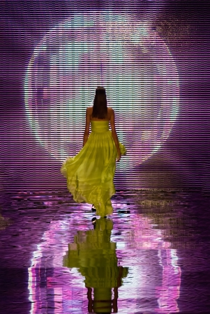 A catwalk model walking away from the stage featuring reflection light globe photo