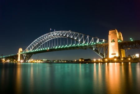Sydney Harbour Bridge By Night with sparkling water reflection Stock Photo