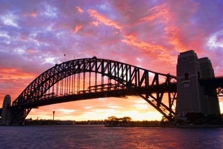 Sydney Harbour Bridge At Dusk with firing sky in background Stock Photo
