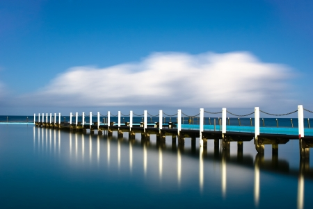 Narrabeen is a famous beach of Sydney, Australia. The pie will lead the eye from near to virtual eternity. Stock Photo