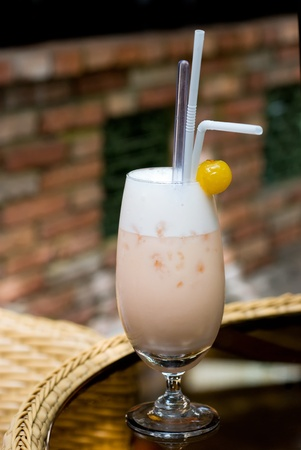 A glass of cocktail drink with straws and fruit Stock Photo