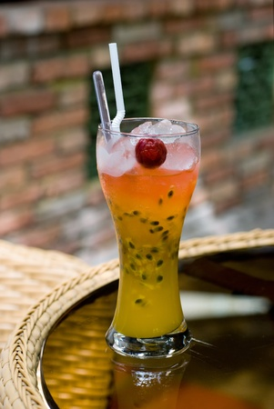 passion fruit: A glass of cocktail drink with straws and fruit Stock Photo