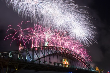 sky line: Sparkling New Year Eve nye Fireworks in Sydney Harbour Sky Line At Night, NSW, Australia, Oceania. The Sydney harbour bridge and sydney opera house sparkling in the night. Colourful surface. Night scene