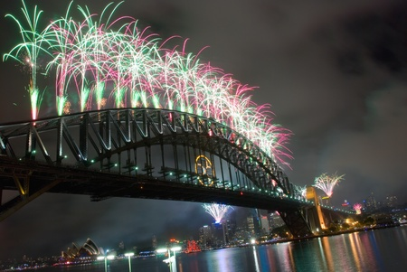 oceania: Sparkling New Year Eve nye Fireworks in Sydney Harbour Sky Line At Night, NSW, Australia, Oceania. The Sydney harbour bridge and sydney opera house sparkling in the night. Colourful surface. Night scene