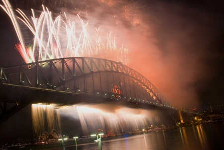 Sparkling New Year Eve nye Fireworks in Sydney Harbour Sky Line At Night, NSW, Australia, Oceania. The Sydney harbour bridge and sydney opera house sparkling in the night. Colourful surface. Night scene Stock Photo - 11426474