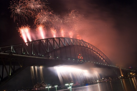 Sparkling New Year Eve nye Fireworks in Sydney Harbour Sky Line At Night, NSW, Australia, Oceania. The Sydney harbour bridge and sydney opera house sparkling in the night. Colourful surface. Night scene
