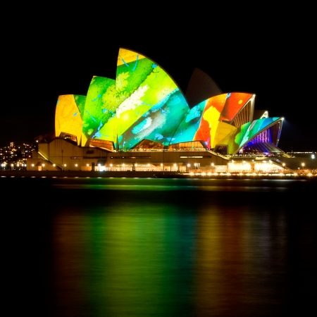 Vivid Colourful Sydney Opera House with reflection on water