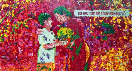 A picture formed by arrining flowers together. This masterpiece is created to celebrate Vietnamese Tet (New Year) with the writing means Children learn to give thanks, tree branch emerge to celebrate New Year