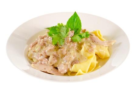 alfredo: A dish of chicken alfredo pasta, isolated on white