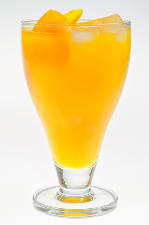 A glass of fresh yellow mango juice, healthy drink photo