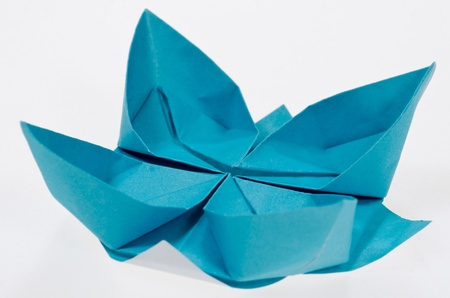 paper folding: Paper folding origami of a lotus isolated on white background Stock Photo