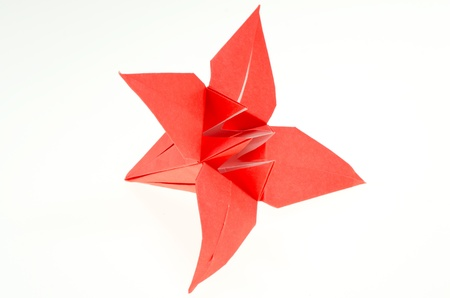 paper folding: Paper folding origami of a lily isolated on white background Stock Photo