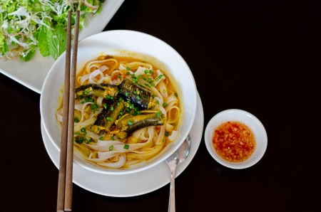 vietnamese food: Vietnamese Eel Noodle  Mi Quang  isolated on black background