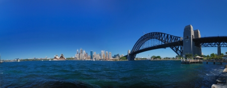 australian scenic: Sydney harbour skyline panorama - blue sky, clear day, city is in the background Stock Photo
