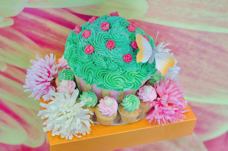 A beautiful cupcake set including a big one and several smaller ones Stock Photo