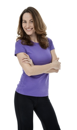 Forty year old woman standing with arms crossed on white background Stock Photo - 18220090
