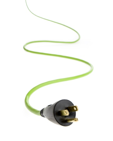 uncluttered: bright green electrical cable with plug in foreground.