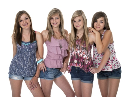 blue jeans kids: Studio photo of four pretty teenage girls in tight group on white. Stock Photo
