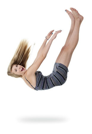Pretty teenage girl upside down appears to be falling out of white space  photo