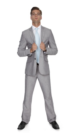 Studio photo of handsome young man wearing a suit on white background.