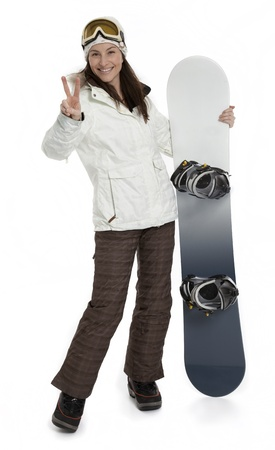 a pretty woman holding snowboard on white background. photo