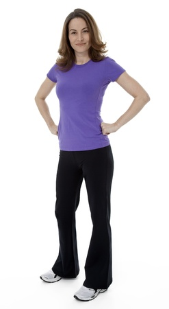 hands on hips: Woman dressed in sportswear with hands on hips, standing on white background.